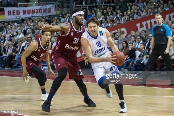 Evgeny Voronov of St Petersburg and Devin Booker of Muenchen battle for the ball during the EuroCup Top 16 Round 3 match between FC Bayern Munich and...