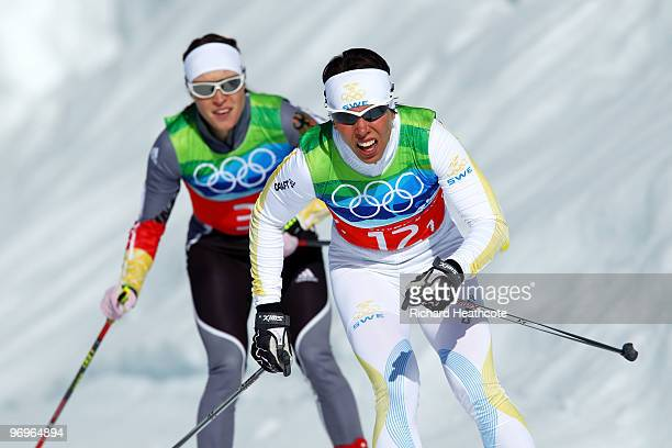 Evi SachenbacherStehle of Germany and Charlotte Kalla of Sweden compete during the cross country skiing ladies team sprint final on day 11 of the...