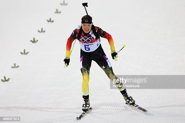 Evi Sachenbacher-Stehle of Germany approaches the finish line in the Women's 7.5 km Sprint during day two of the Sochi 2014 Winter Olympics at Laura...