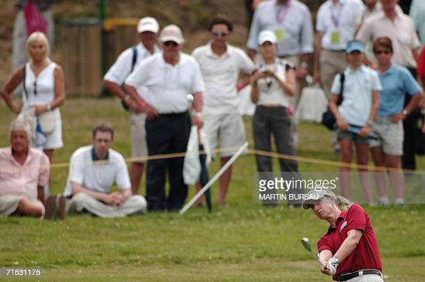 Australian Karrie Webb plays out of the rough 28 July 2006 in EvianlesBains central eastern France on the third of the four days of the Golf Evian...