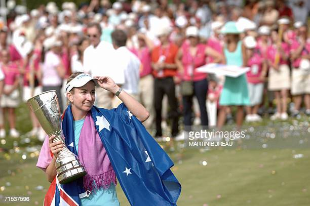 Australian Karrie Webb poses for photographers with her trophy 29 July 2006 in EvianLesBains central eastern France on the last of the four days of...