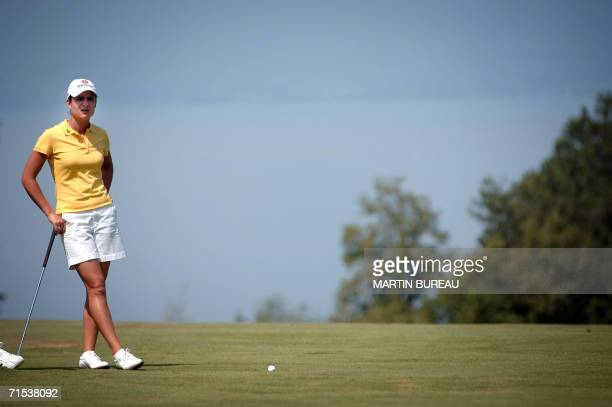 Mexican Lorena Ochoa concentrates before playing out of the fairway 29 July 2006 in EvianLesBains central eastern France on the last of the four days...