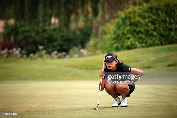 SouthKorean Mi Hyun Kim concentrates before a put 29 July 2006 in EvianLesBains central eastern France on the last of the four days of the Golf Evian...