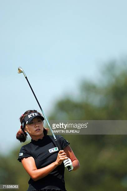 SouthKorean Mi Hyun Kim watches her drive 29 July 2006 in EvianlesBains central eastern France on the last of the four days of the Golf Evian Masters...