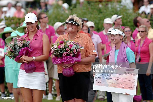 US Michelle Wie British Laura Davies and Australian Karrie Webb pose for photographers 29 July 2006 in EvianLesBains central eastern France on the...