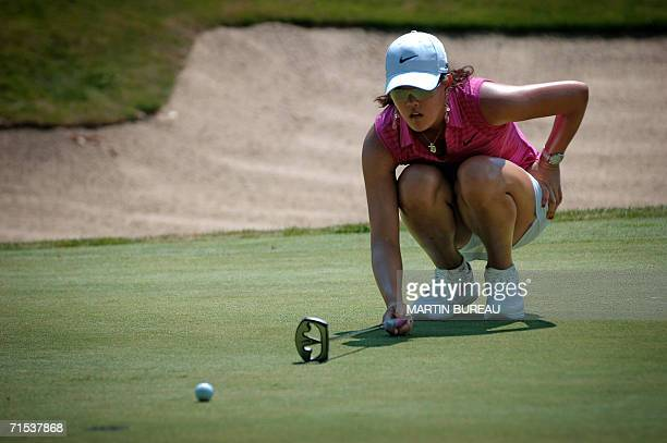 US Michelle Wie concentrates before a put 29 July 2006 in EvianlesBains central eastern France on the last of the four days of the Golf Evian Masters...