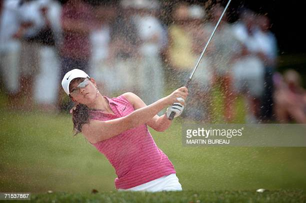 US Michelle Wie plays out of the bunker 29 July 2006 in EvianLesBains central eastern France on the last of the four days of the Golf Evian Masters...