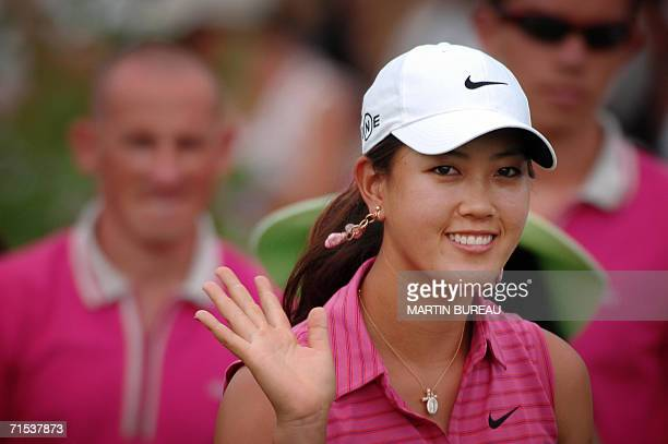 US Michelle Wie waves to the crowd 29 July 2006 in EvianlesBains central eastern France on the last of the four days of the Golf Evian Masters...
