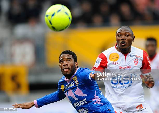 Evian's Brazilian defender Betao vies for the ball with Nancy's Cameroonian forward Paul Alo'o Efoulou during the French L1 football match Nancy vs...