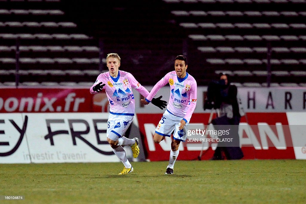Evian's Danish defender Daniel Wass (L) celebrates after scoring during their French L1 football match Evian (ETGFC) vs Ajaccio (ACA) on January 26, 2013 at the city stadium Parc des sports in Annecy, eastern France.