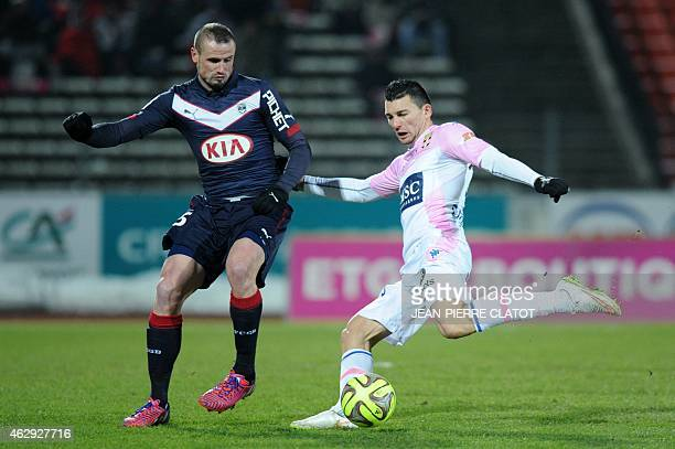 Evian's French forward Mathieu Duhamel vies with Bordeaux's French defender Nicolas Pallois during the French L1 football match Evian against...