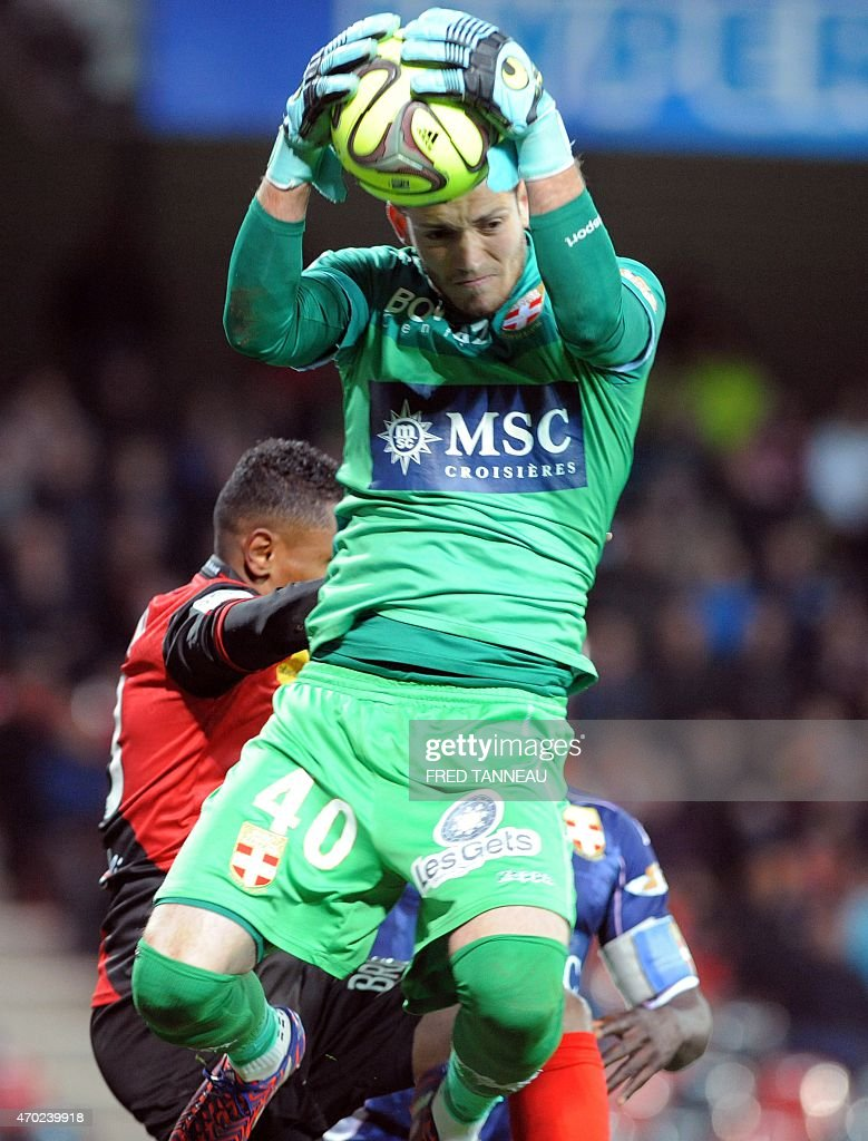 Evian's French goalkeeper Benjamin Leroy catches the ball during the French L1 football match between Guingamp and Evian on April 18, 2015 at the Roudourou stadium in Guingamp, western of France.