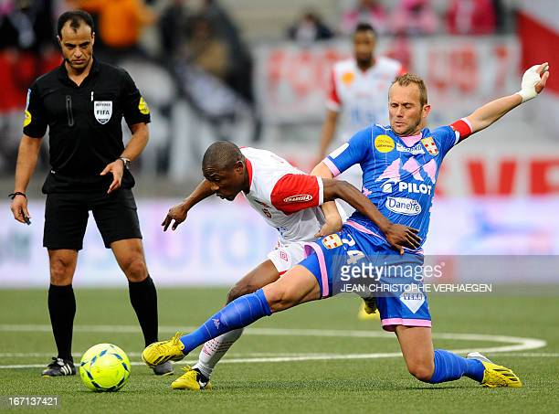 Evian's French midfielder Olivier Sorlin with Nancy's Cameroonian forward Paul Alo'o Efoulou during their French L1 football match Nancy vs Evian at...
