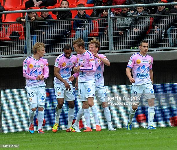 Evian's Tunisian froward Saber Khalifa celebrates with teammates after scoring during their French L1 football match Valenciennes vs EvianThonon on...
