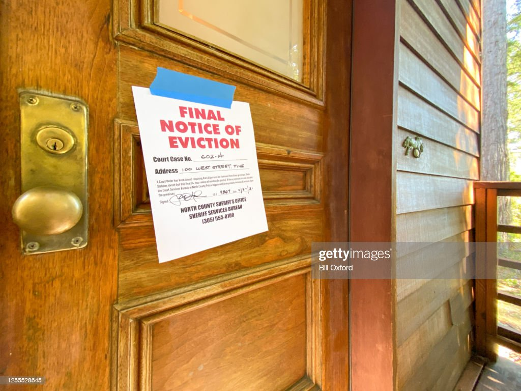 Eviction notice on door of house : Stock Photo