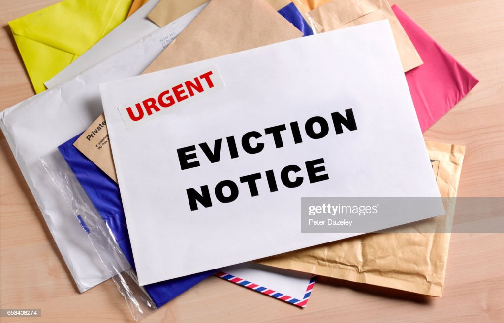 Eviction notice on door step : Stock Photo