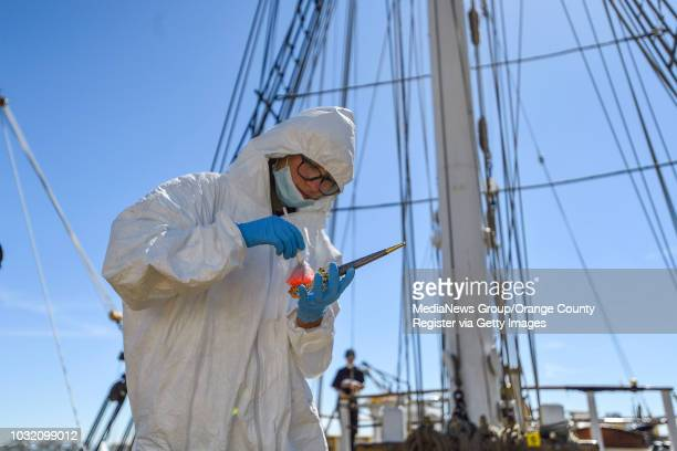 Evidence collector Gabby Finkelstein looks for fingerprints aboard the Pilgrim tall ship as she joins fellow members of the Thurston Middle School...