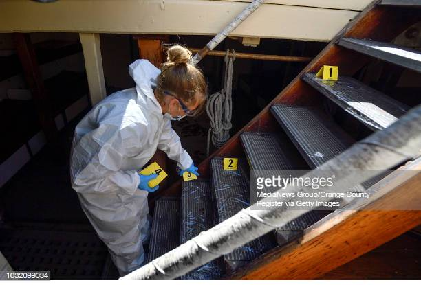 Evidence collector Rebecca Storke places markers aboard the Pilgrim tall ship as she joins fellow members of the Thurston Middle School forensics...
