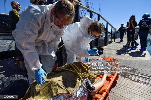 Evidence collectors Rebecca Storke left and Gabby Finkelstein examine a fake body recovered in the water as they join fellow members of the Thurston...