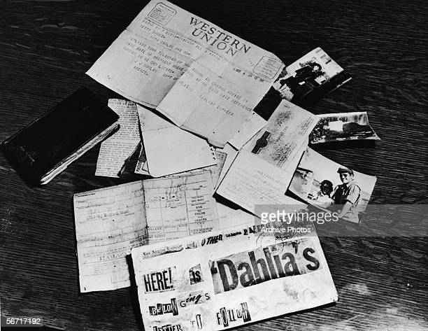 Evidence concerning the murder of American aspiring actress and murder victim Elizabeth Short known as the 'Black Dahlia' is strown across a table at...