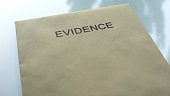 Evidence, folder with important documents lying on table, police investigation