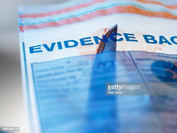 evidence from knife crime incident in forensic bag - criminal investigation stock pictures, royalty-free photos & images