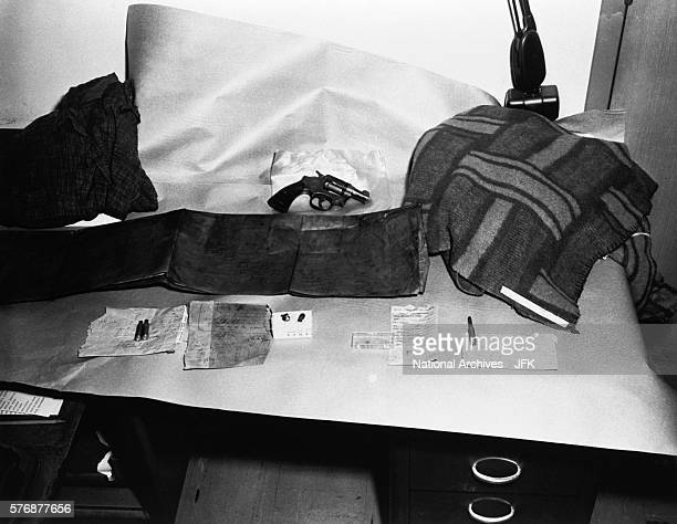 Evidence from the assassination of President Kennedy in 1963 includes a cardboard box from the Texas School Book Depository brown paper used to...