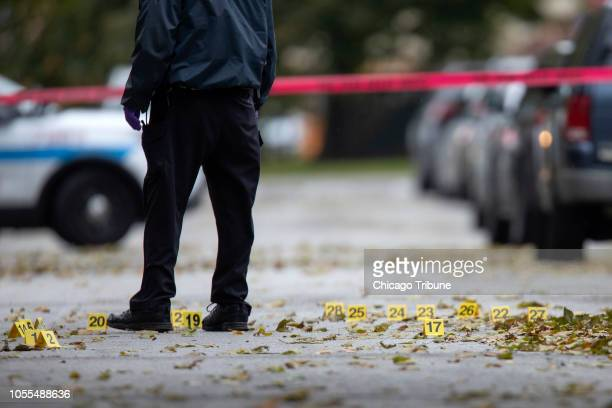Evidence markers are scattered among leaves at the scene of a fatal shooting in the 5500 block of South La Salle Street Sunday Oct 28 in the...