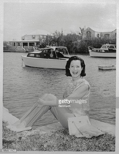 Evidence of enjoying the surrounding landscape is made definite by the smile on Kitty Carlisle's face Kitty the wife of the late Mos Hart Director...