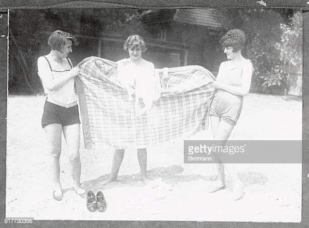 Evidently they have no beach censors at German seashore resorts for these three young women had to dress on the beach for their plunge in the third...