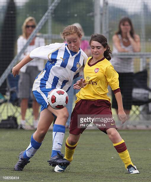 Evie Clarke of Colchester United is tackled by Phillippa Cowley of Arsenal Ladies Under 14 Team event during the Arsenal Ladies Cup 2010 at the...