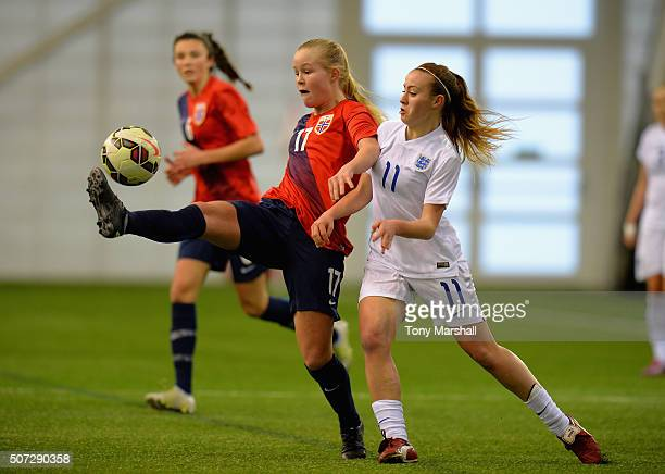 Evie Clarke of England challenges Vilde Hasund of Norway during the U19 Women's Friendly match between England U19 Women and Norway U19 Women at St...