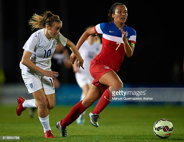 Evie Clarke of England competes for the ball with Samantha Hiatt of USA during the women's U19 international friendly match between England U19 and...