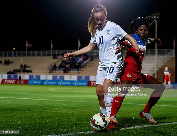 Evie Clarke of England competes for the ball with Taylor Mitchell of USA during the women's U19 international friendly match between England U19 and...