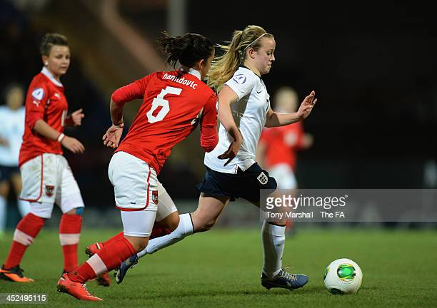 Evie Clarke of England gets away from Adina Hamidovic of Austria during the UEFA Women's U17 Championship Finals match between England and Austria at...