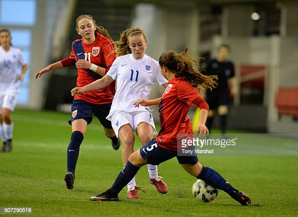 Evie Clarke of England is tackled by Heidi Ellingsen of Norway during the U19 Women's Friendly match between England U19 Women and Norway U19 Women...