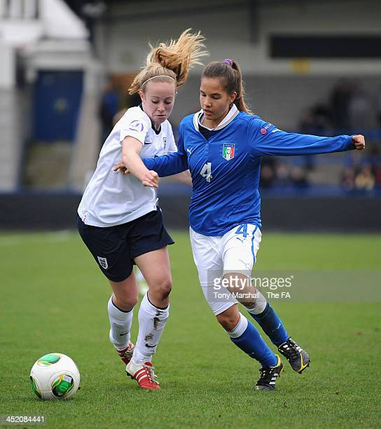Evie Clarke of England tackles Federica Cavicchia of Italy during the UEFA Womens U17 Championship Finals match between England and Italy at the AFC...