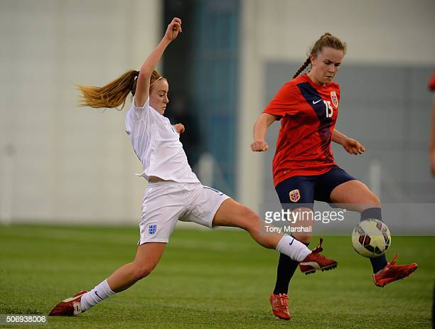 Evie Clarke of England tackles Marit Bratberg Lund of Norway during the U19 Women's Friendly match between England U19 Women and Norway U19 Women at...
