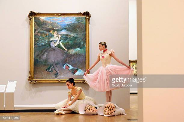Evie Ferris and Georgia ScottHunter Artists of The Australian Ballet next to one of Edgar Degas' iconic ballet dancer paintings 'Dancer with...