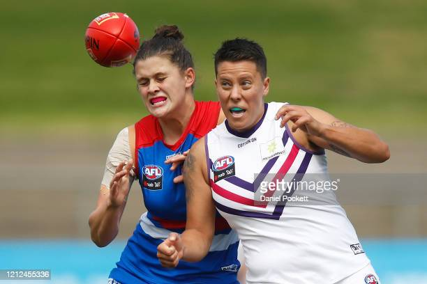 Evie Gooch of the Dockers and Nell Morris-Dalton of the Bulldogs compete for the ball during the round six AFLW match between the Western Bulldogs...
