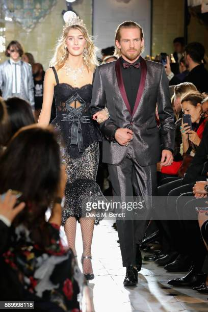 Evie Henderson and Jacobi Anstruther Gough Calthorpe walk the Dolce Gabbana Italian Christmas catwalk show at Harrods on November 2 2017 in London...