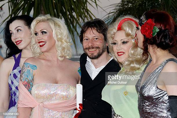 Evie Lovell Julie Atlas Muz Mathieu Amalric Kitten on the Keys and Dirty Martini and Mimi Le Meaux attends the Palme d'Or Award Photocall held at the...