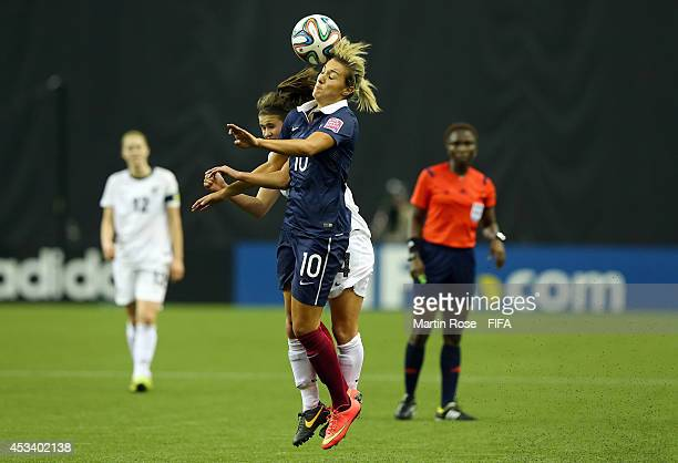 Evie Millynn of New Zealand and Claire Lavogez of France battle for the ball during the FIFA U20 Women's World Cup 2014 group D match between New...