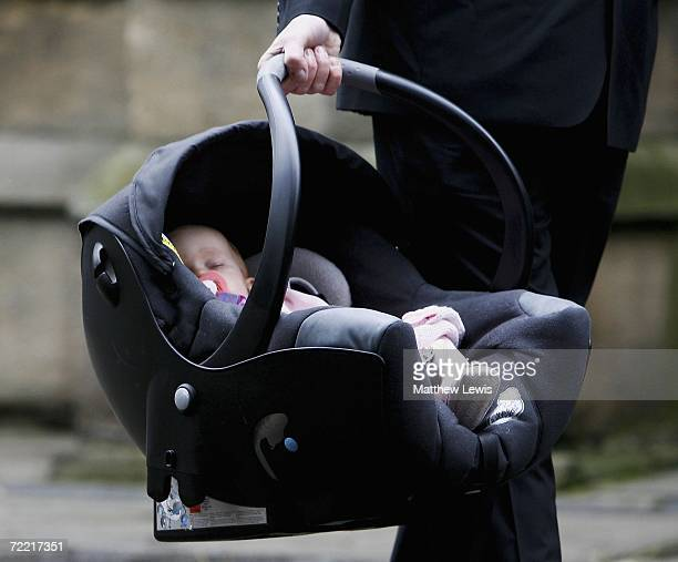 Evie Rose daughter of Paul Hunter is carried into her father's funeral at Leeds Parish Church on October 19 2006 in Leeds England The threetime...