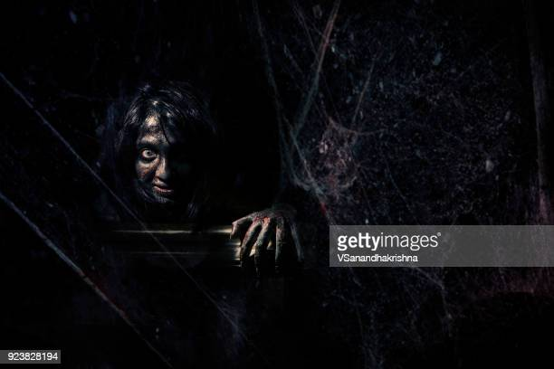 evil behind the spider web in dark - evil stock pictures, royalty-free photos & images