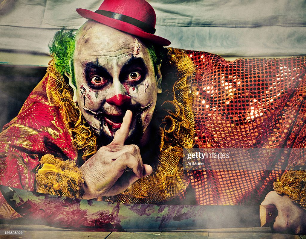 Evil Clown under bed : Stock Photo