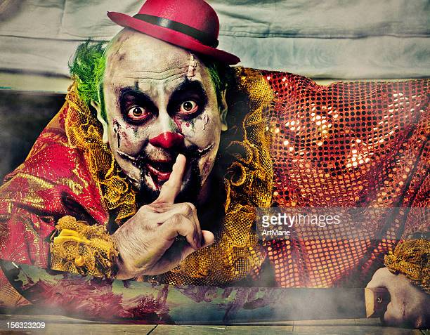 evil clown under bed - zombie makeup stock photos and pictures
