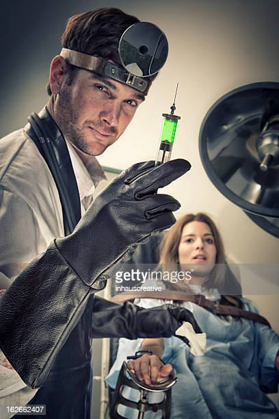 Evil Doctor trying out new serum on his female victim