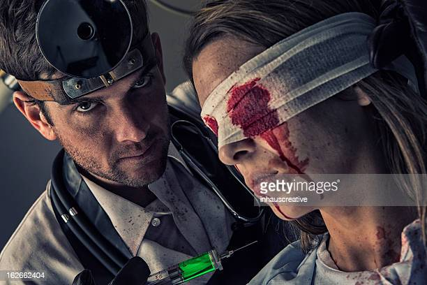 Evil Doctor trying out toxic serum on his female victim