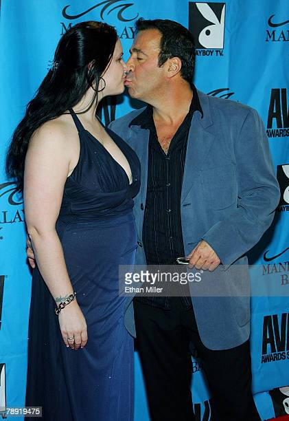 Evil Empire director and executive Karen Stagliano kisses her husband adult film producer and director John Stagliano as they arrive at the 25th...